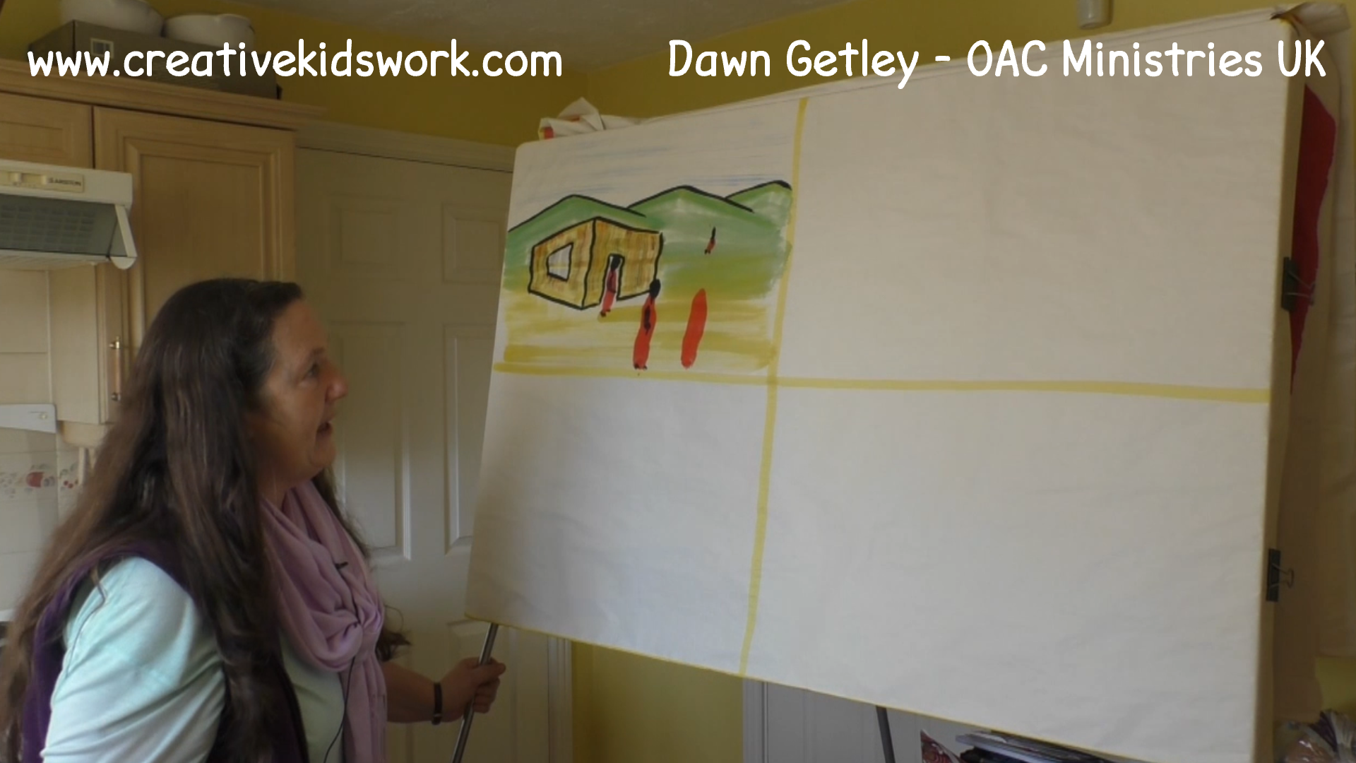 Dawn Getley demonstrates how to paint a general landscape with a house in it on a sketchboard painting