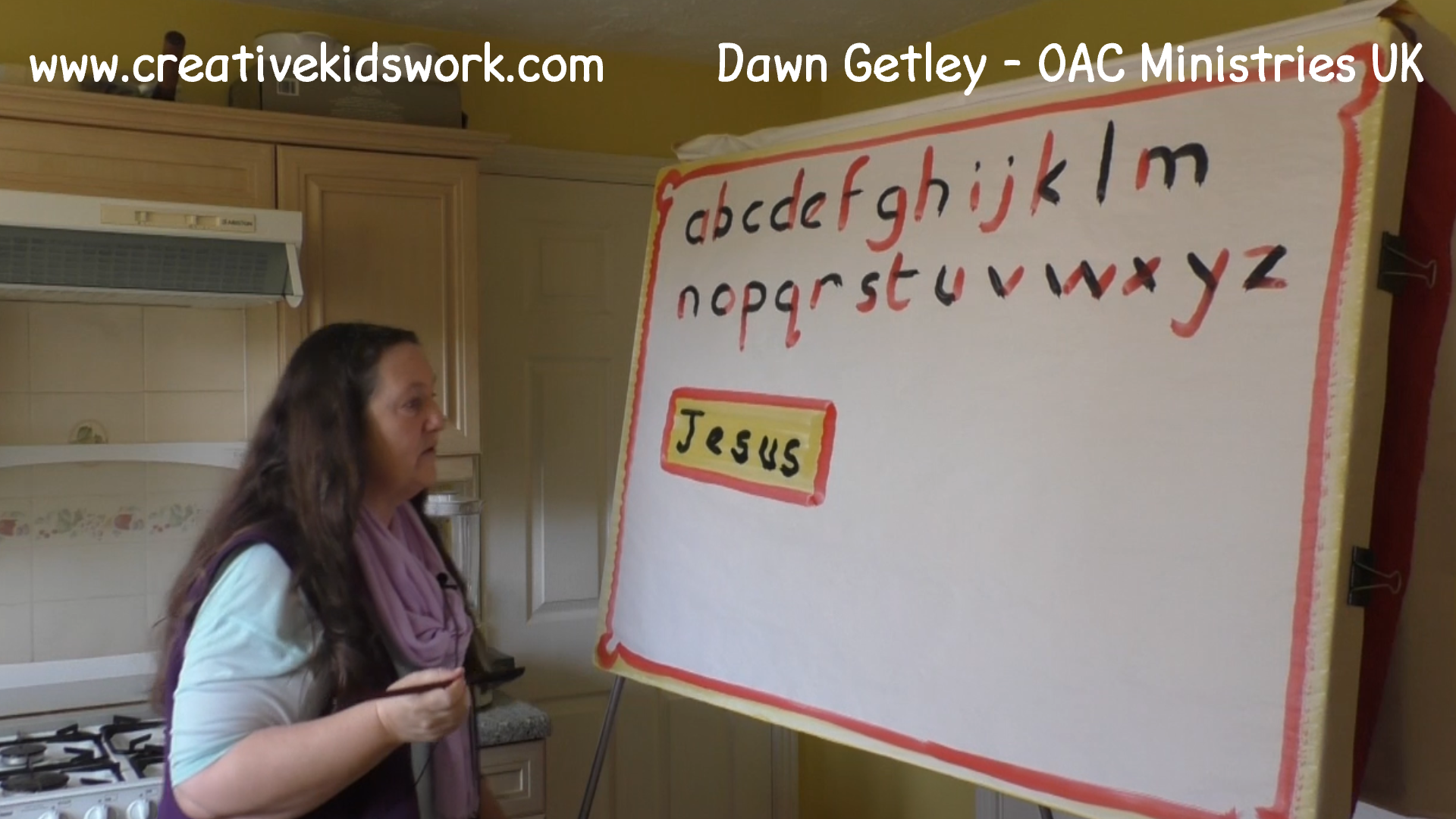 Dawn Getley demonstrates how to paint partial lettering on a sketchboard painting